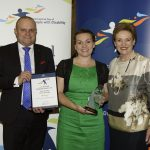 excellence in justice and rights protection award joint winner kerri casidey and husband with assistant minister prentice