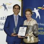 excellence in technology award winner dr abolfathi and assistant minister prentice